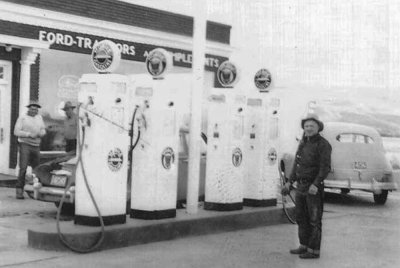 Historical Image of Parnell Johnson in front of gas pumps