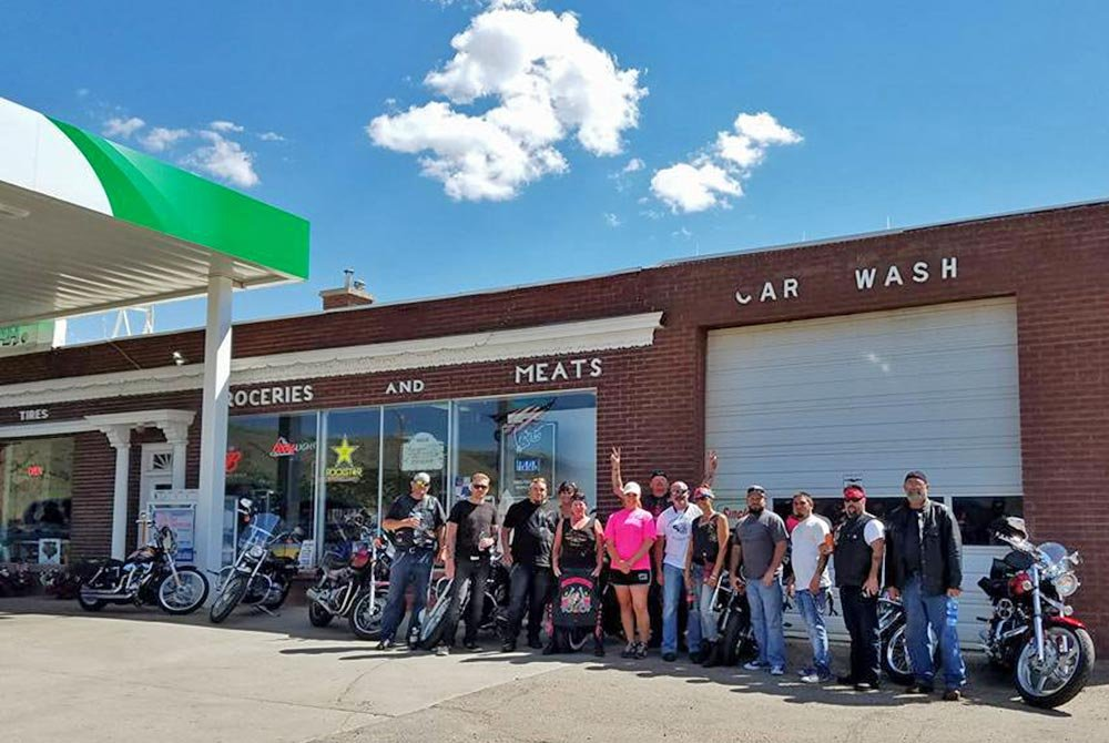 Group of people infront of bikes and car wash ice cream store