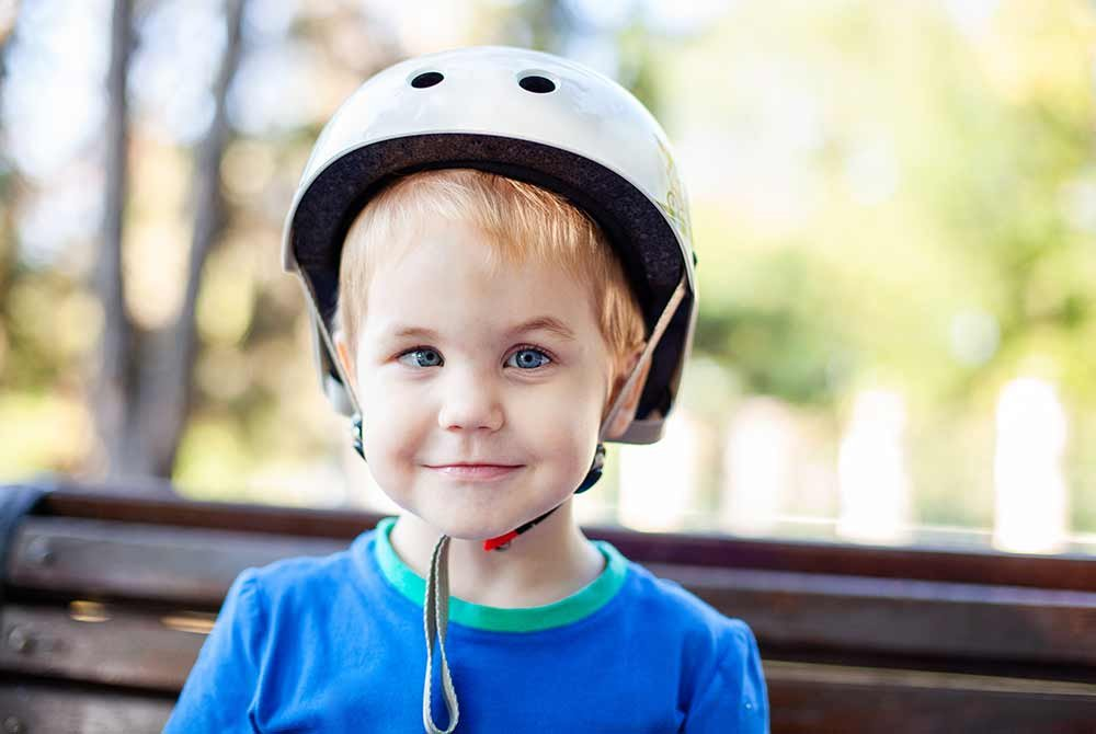boy with bike helmet outside
