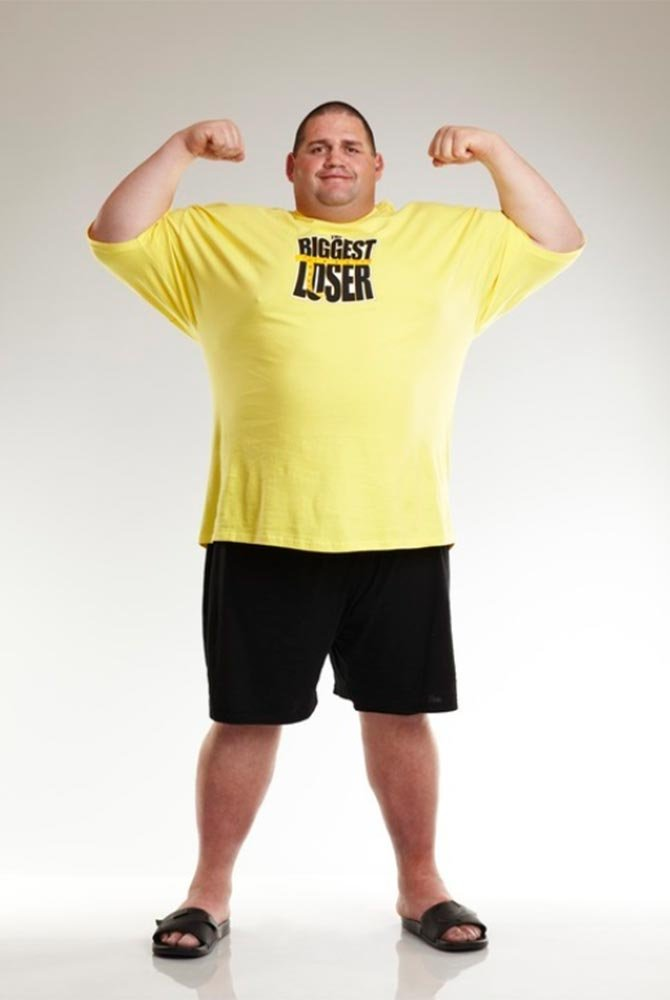 Rulon flexing in biggest loser shirt