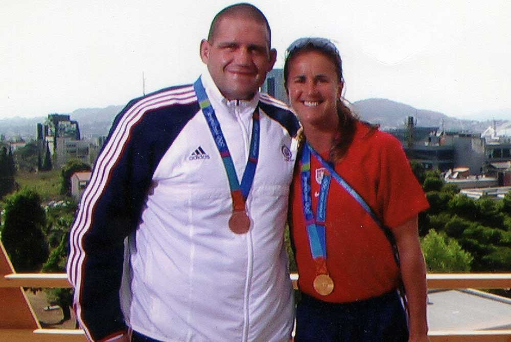 Rulon and his coach posing with medals