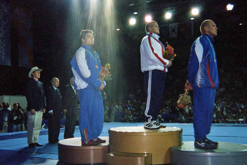 Rulon standing on podium after match