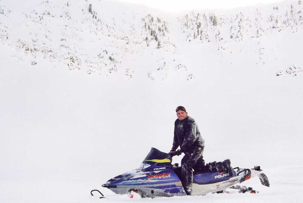 Rulon on a snowmobile