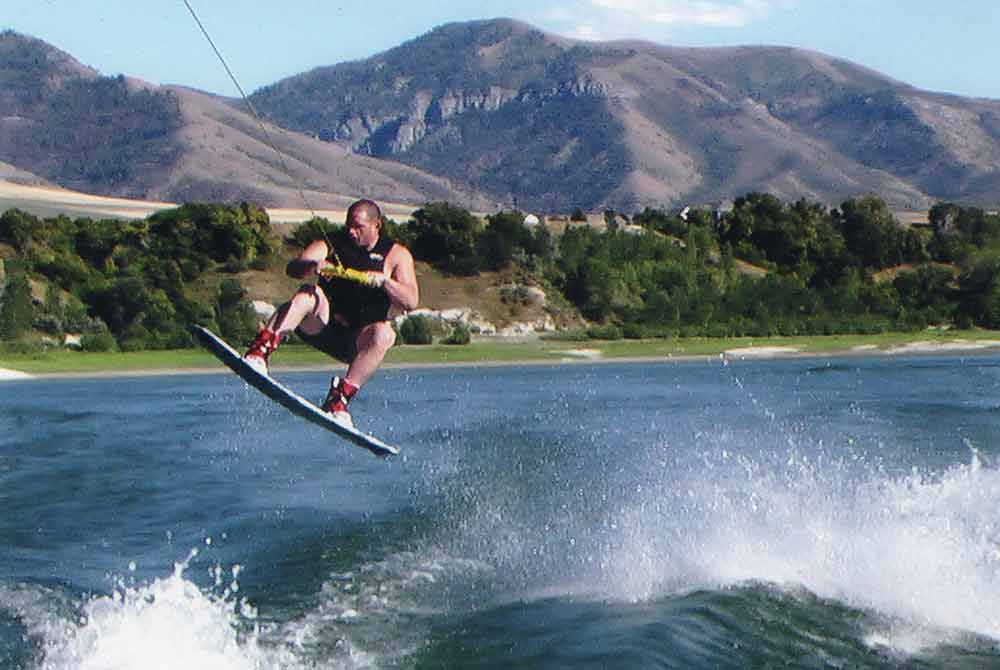 Rulon wakeboarding on a lake