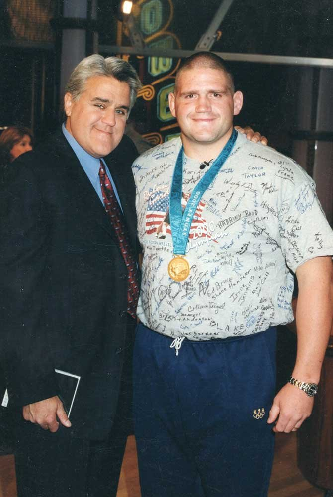 Rulon posing in signed shirt and medal
