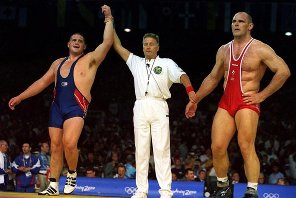 Referee holding up Rulon's arm