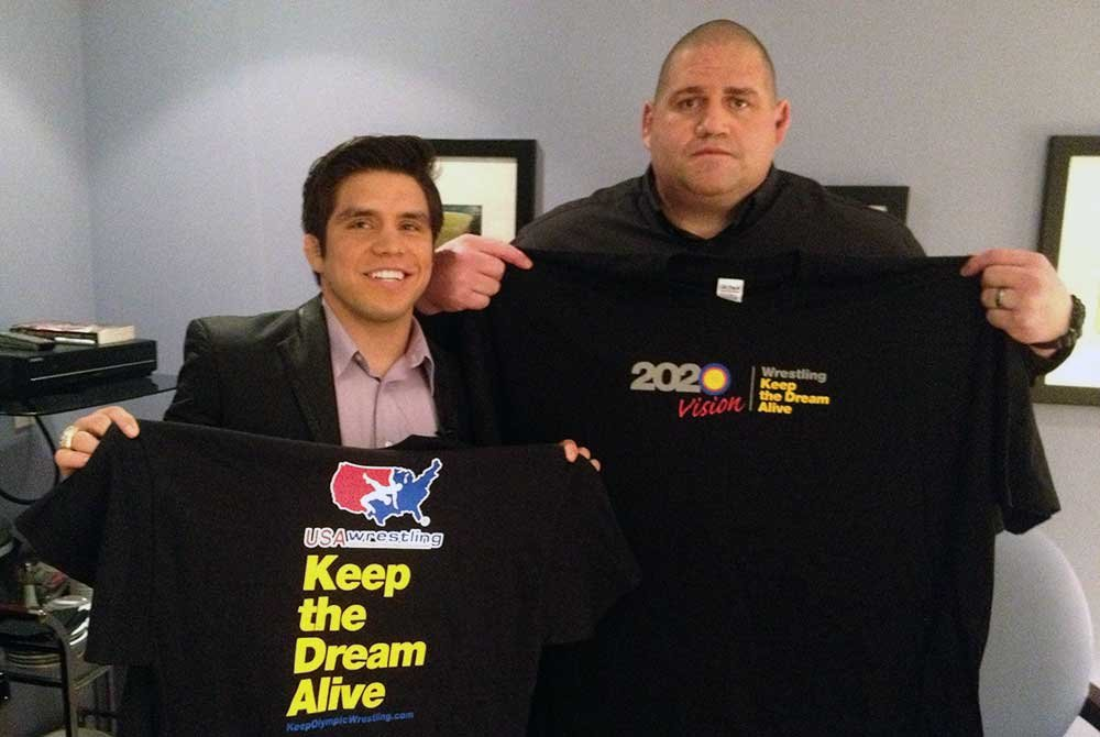 Rulon and man holding up Keep the Dream Alive shirts