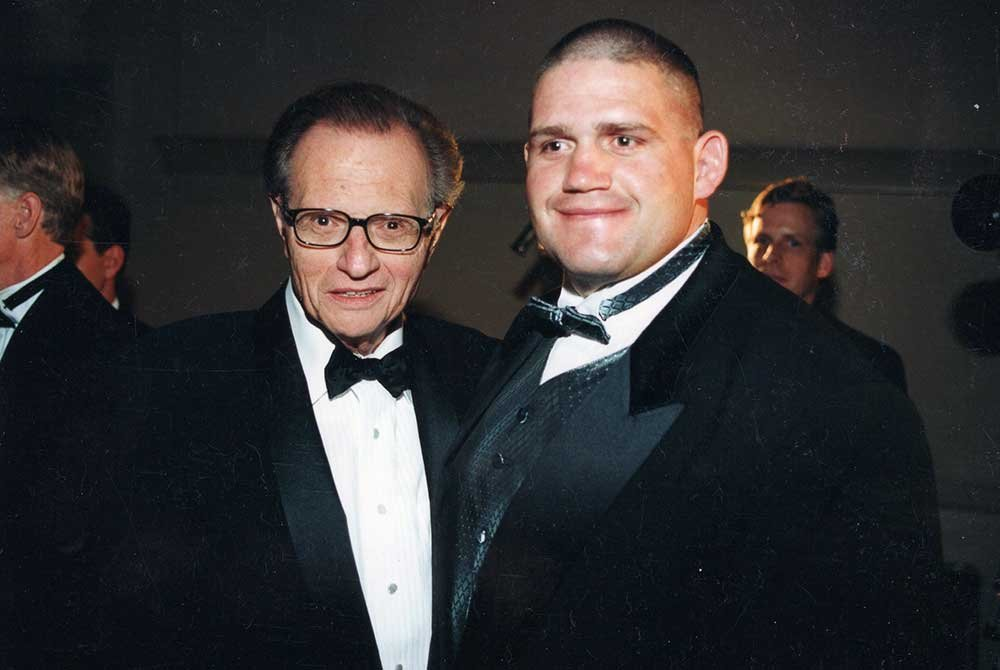 Rulon and talk show host posing for picture