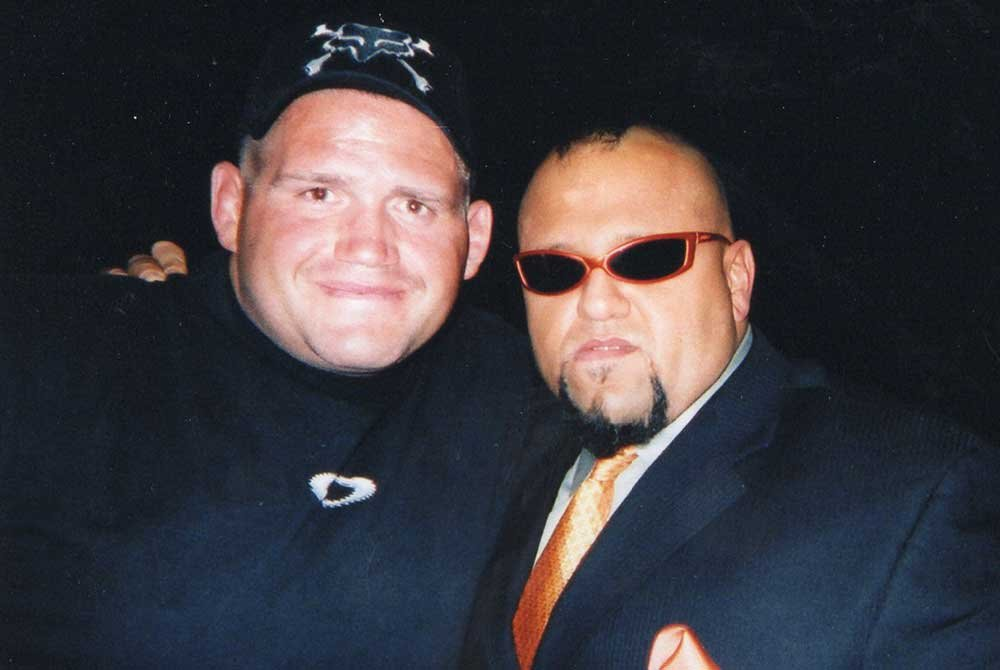 Rulon and man with glasses posing together