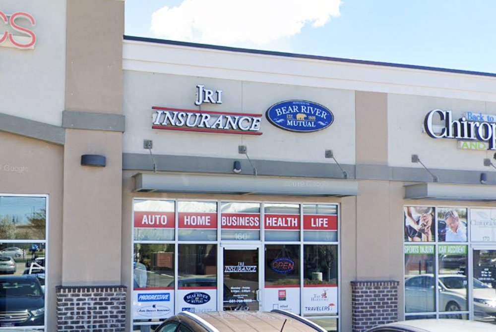 commercial building with signs that say JRI Insurance and Bear River Mutual