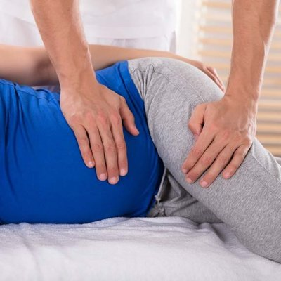 Chiropractor giving pregnant patient an adjustment