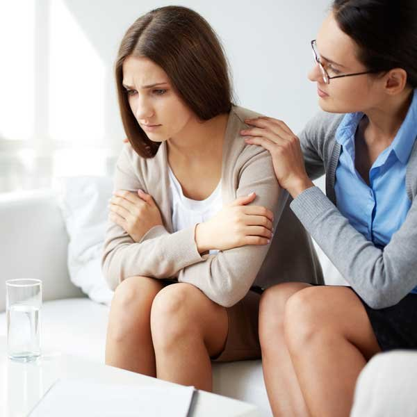 Woman being comforted