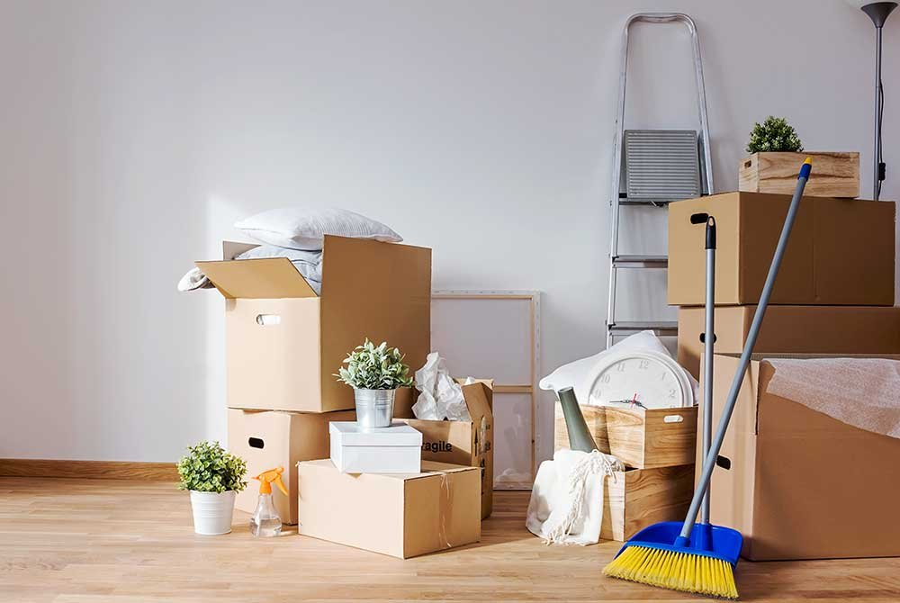 Boxes, ladder, and broom
