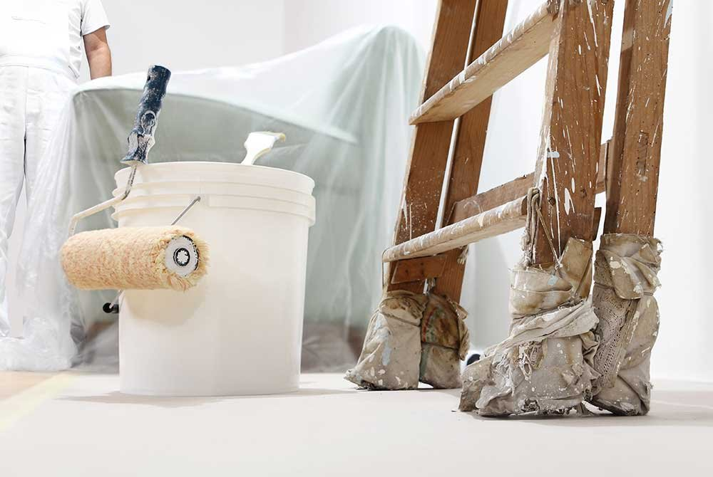 Ladder, paint bucket, and tarp