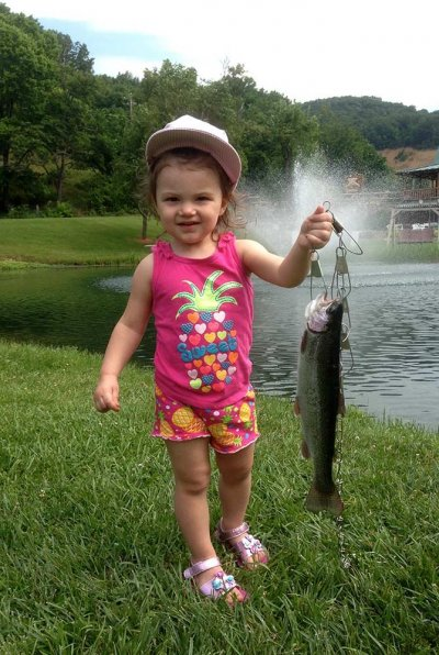 Young girl holding fish on hook