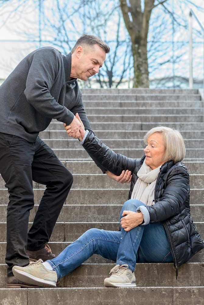 Man helping woman on steps