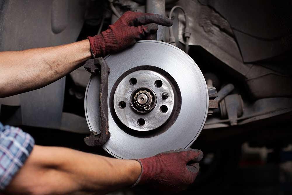 Mechanic adjusting brake pads