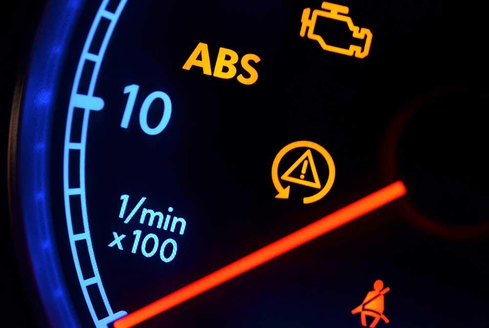 Warning signs glowing on speedometer
