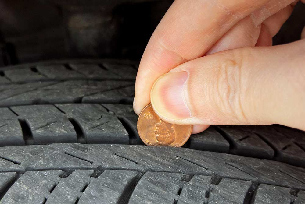 Penny against treads in a tire