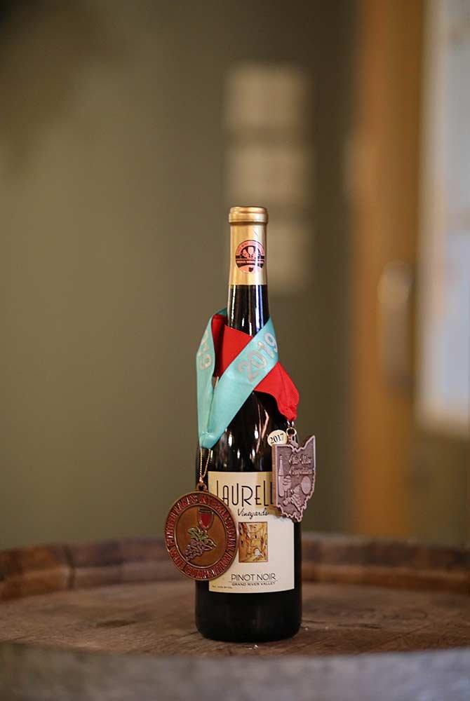 Laurello Pinot Noir wine bottle with medals