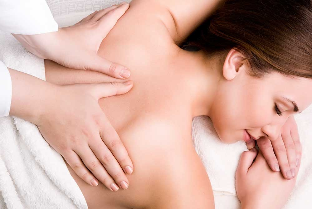 woman receiving spinal massage