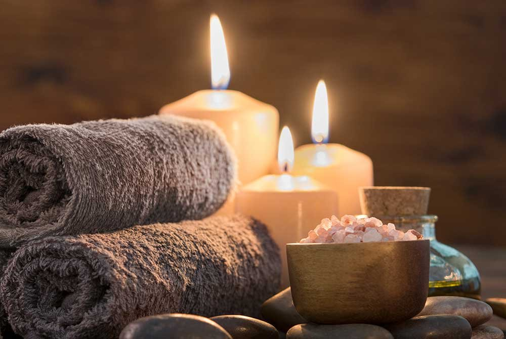 Candles burning and rolled towels