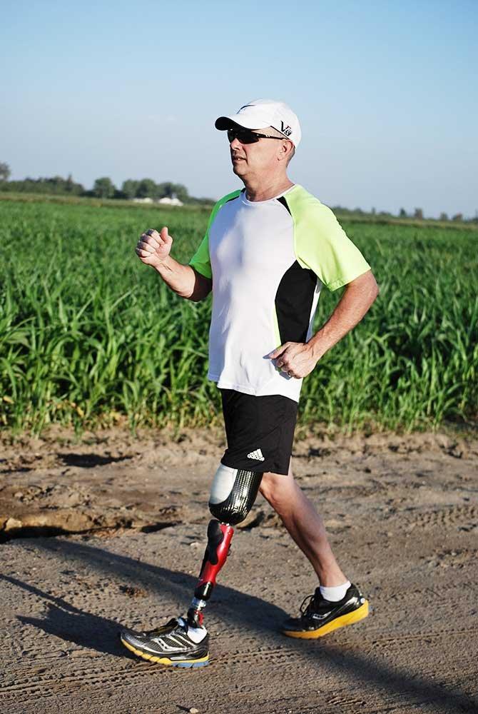 Man with prosthetic leg walking