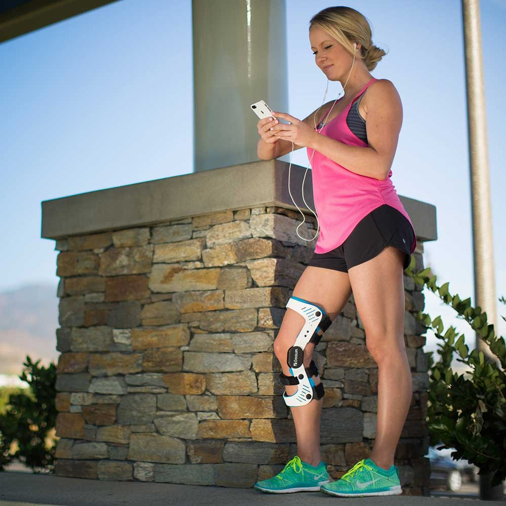 Woman getting ready to run with a knee brace