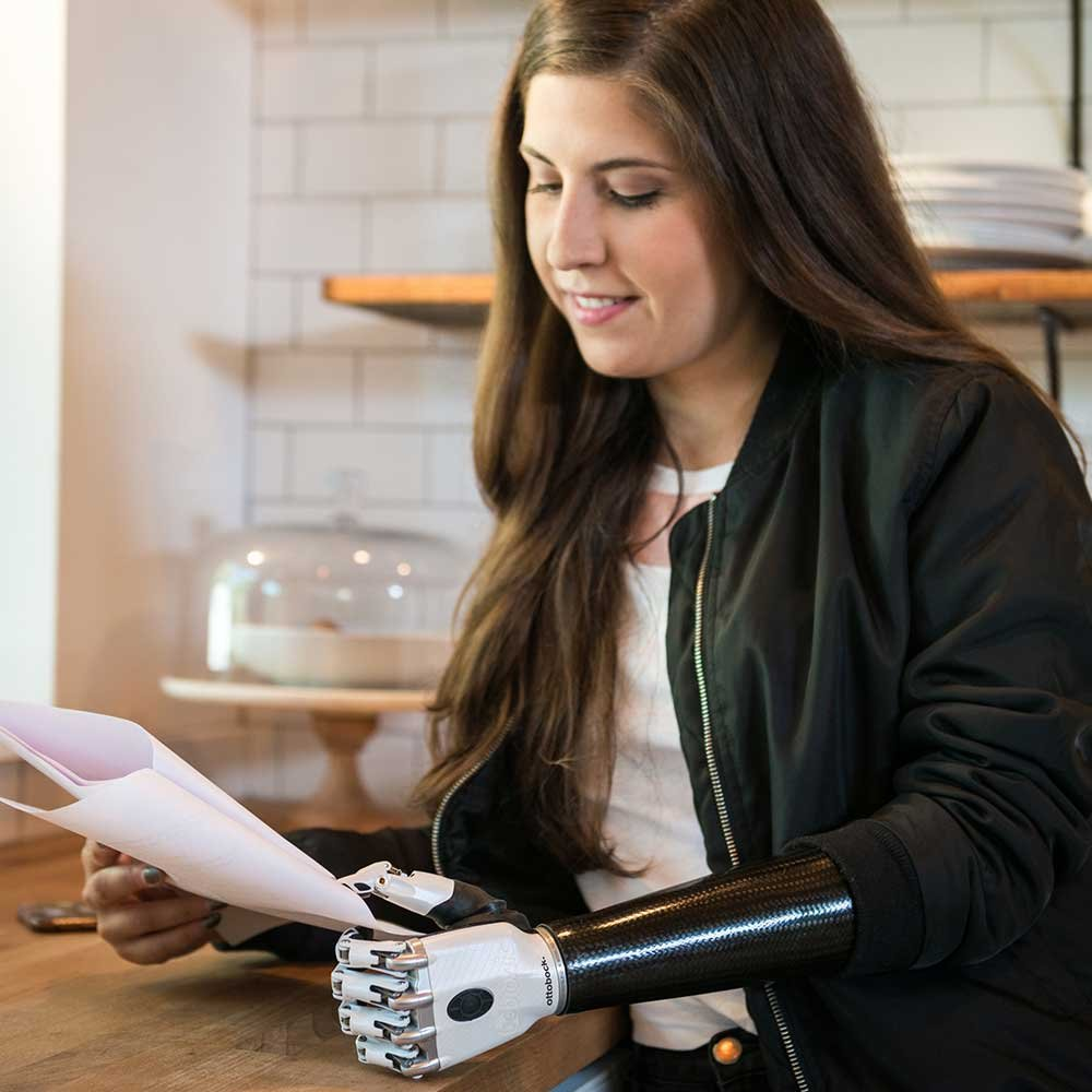 Woman with prosthetic arm reading