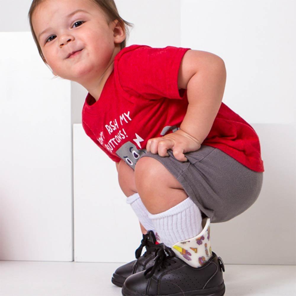 Young boy wearing leg braces