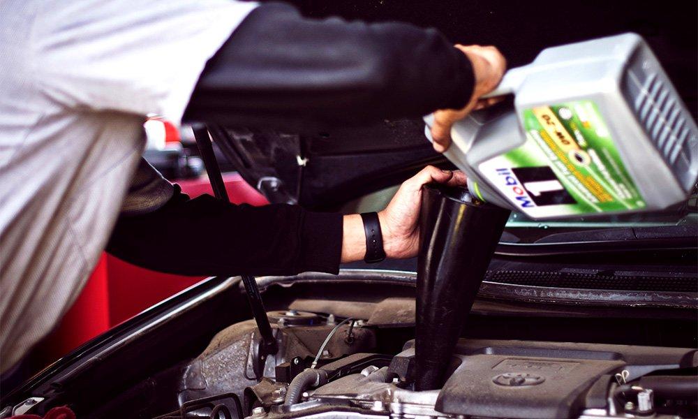 man changing car oil