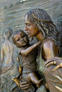 Bronze statue of woman holding young child