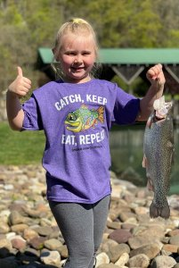 blonde girl holding caught fish