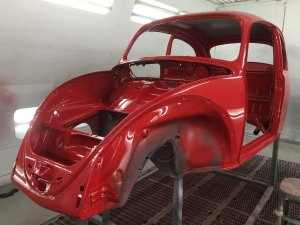 Volkswagen beetle frame being painted