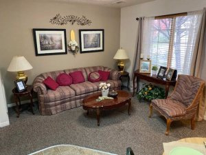 Family room with couch, chair, and coffee table