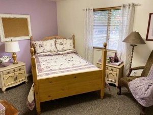 double bed with wood posts