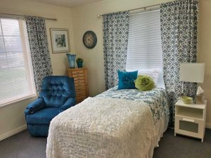 Twin bed with comforter and decorative pillows