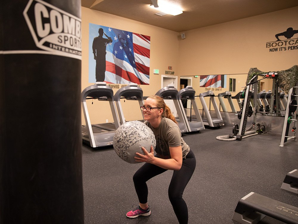 woman working out with weighted ball
