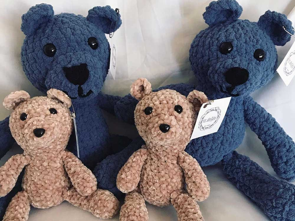 two small brown bears and two large blue bears