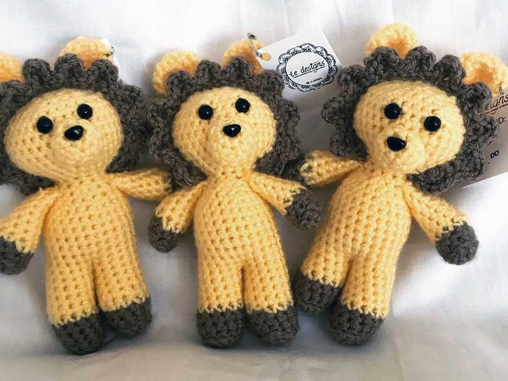Three crocheted lions