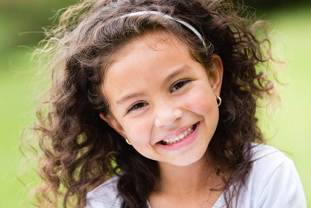 Smiling little girl with curly hair