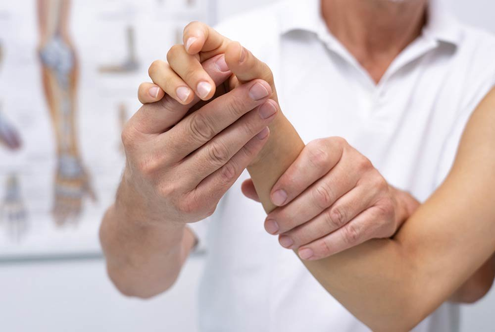 woman receiving physical therapy on wrist