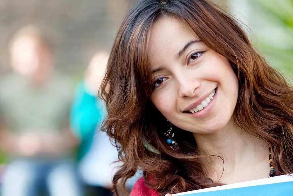 Latina student holding a book