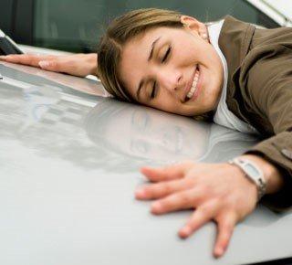 Woman embracing her car