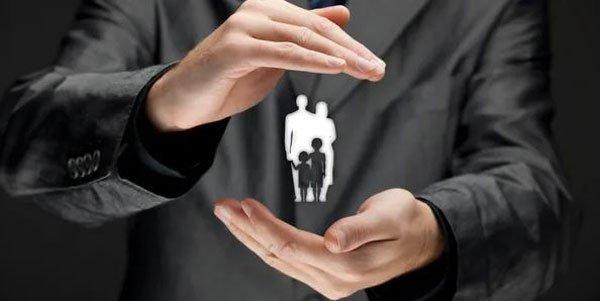 Hands surrounding family icon